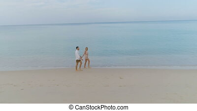 Beautiful couple on holiday - Aerial view of beautiful...