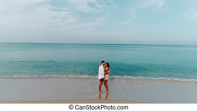 Beautiful couple on holiday - Aerial view of romantic happy...