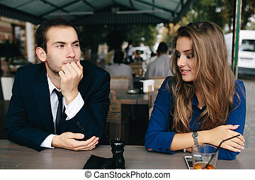 beautiful couple sitting in the cafe