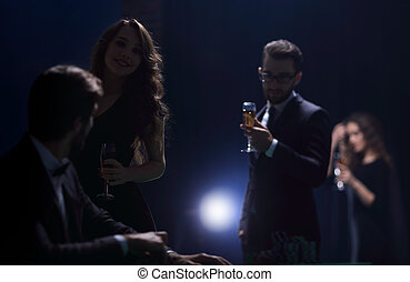 beautiful couple spends an evening in the casino