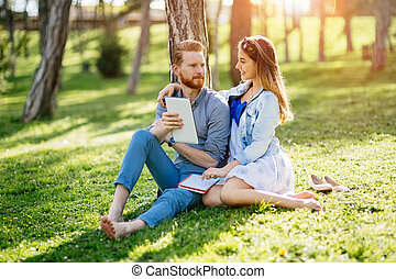 Beautiful couple studying together for exams