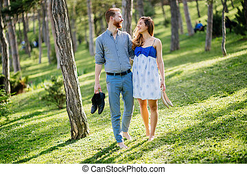 Beautiful couple taking a walk in city park