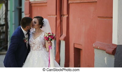 Beautiful couple walking in old historical town FullHD