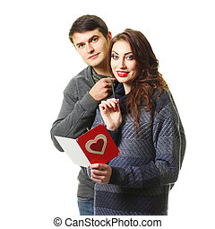 beautiful couple with a card on Valentine's Day