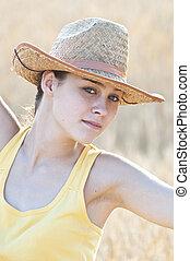 Beautiful cowboy girl posing