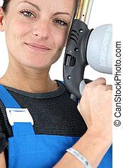 beautiful craftswoman holding a welding torch