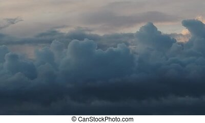 Beautiful Cumulus clouds flying across the sky, twilight -...