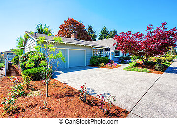 Beautiful curb appeal of small American house. Two garage...
