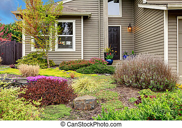 Beautiful curb appeal - Siding house entrance with beautiful...
