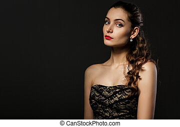beautiful curly woman in black dress