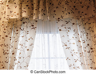 Beautiful curtains with flowers paint in a room