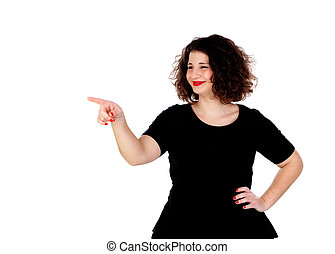 Beautiful curvy girl with black dress indicating something with the finger