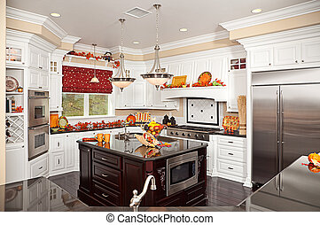 Beautiful Custom Kitchen Interior With Fall Decorations in a...