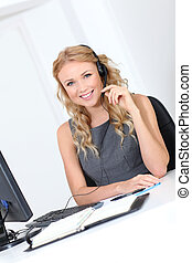 Beautiful customer-service woman with headset on