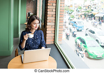 Beautiful cute asian young woman in the cafe, enjoy drinking coffee smiling