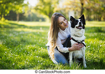 Beautiful cute dog in nature taken for walk by people