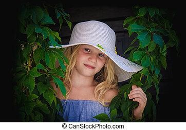 beautiful cute girl in white hat portrait