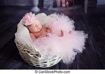 cute little girl sleeping in a basket