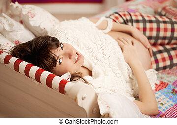 Beautiful cute pregnant woman indoors - Beautiful pregnant...