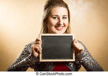 cute woman posing with black chalkboard