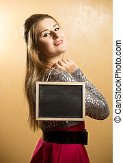 cute woman posing with blank blackboard