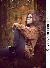 Beautiful cute woman resting in the forest
