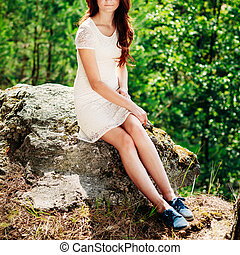 Cute Young Woman Girl In White Dress Sitting On Stone In Summer
