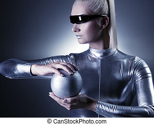 Beautiful cyber woman with silver ball