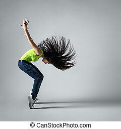beautiful dancer girl squatting with flying hair - beautiful...