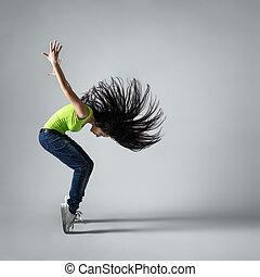 beautiful dancer girl squatting with flying hair - beautiful...