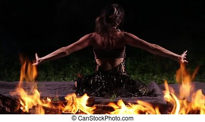 Beautiful dancer in the fire flames - Beautiful young woman...