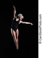 Beautiful dancer suspended in air - Beautiful young woman...