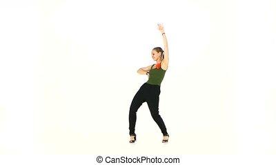 Beautiful dancer woman starts dancing social latino dance...