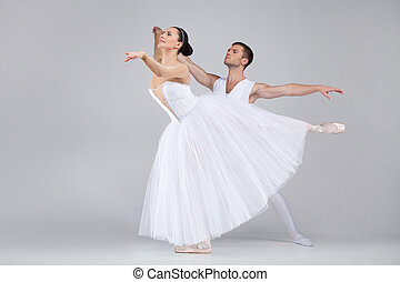 beautiful dancing couple performing ballet. man and woman practicing ballet dance