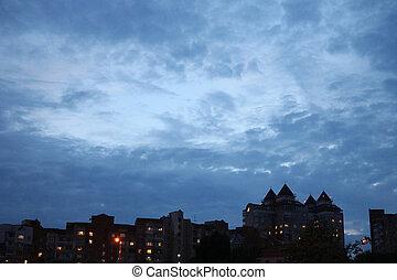 beautiful dark blue evening sky in the city