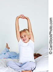 Beautiful daughter stretching after sleeping - Beautiful...