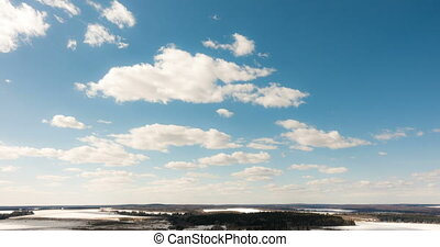 Beautiful daytime timelapse of clouds over the winter landscape