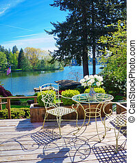 Beautiful deck with lake view and spring landscape.