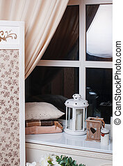Beautiful decor in beige tones near the window.