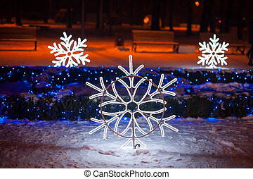 Beautiful decor of snowflakes in winter Park