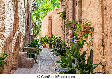 Beautiful decorated porch in small town in Italy in sunny day, Umbria
