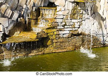 Beautiful decorative garden stone waterfall pond