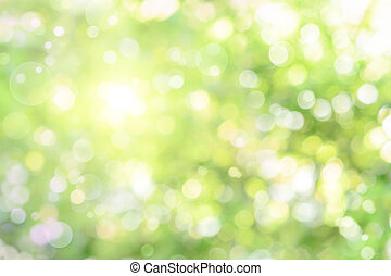 Beautiful defocused highlights in foliage create a bright bokeh composition, ideal as a nature background