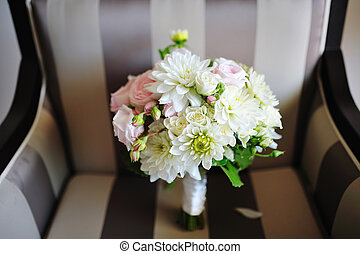 beautiful delicate wedding bouquet on a chair