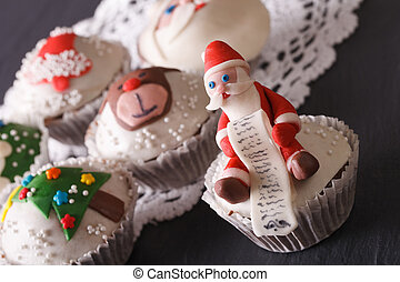 delicious cupcakes with Christmas decorations close-up. Horizontal