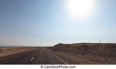 Beautiful desert view. Car driving on the road to Eilat, Israel. Inside view of a car. 4K. High quality 4k footage
