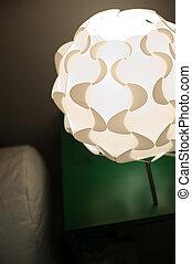 Beautiful designer desk lamp in the interior
