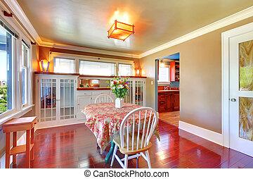 Beautiful dining room with shiny cherry hardwood. - ...
