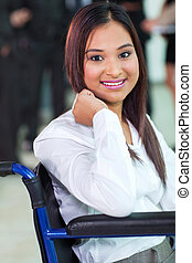 beautiful disabled office worker in a wheelchair
