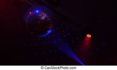 Beautiful Disco Ball Spinning seamless with flares. Mirror ball with bright rays, night party background footage. SLow motion.